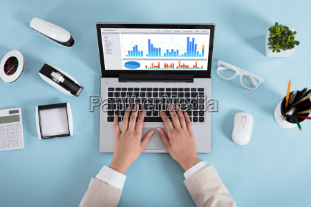 businesswoman analyzing graphs in office