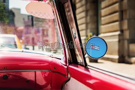 cuba havana cuban flag reflecting in