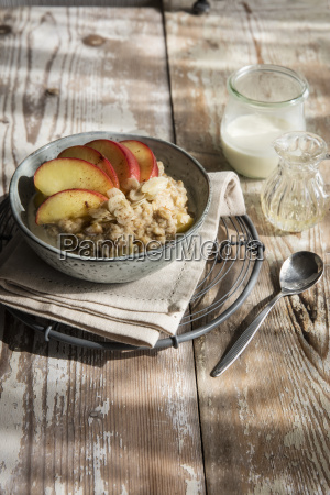 bowl of porridge with apple and