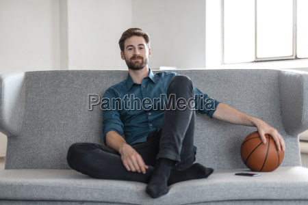 portrait of relaxed young man sitting